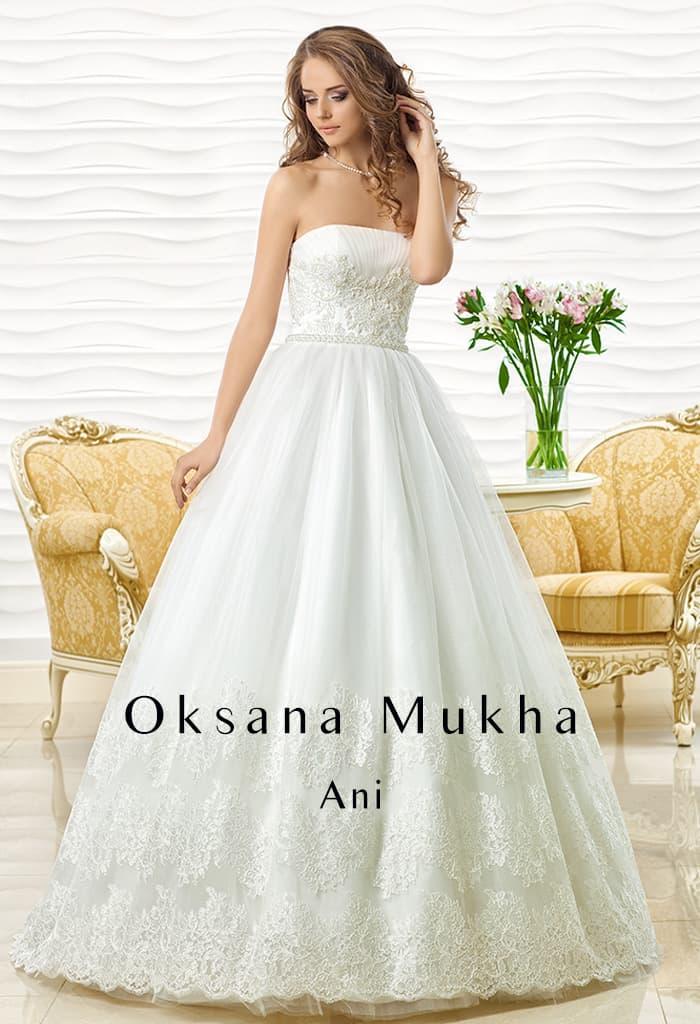 Впечатляющее свадебное платье с торжественной юбкой и лифом прямого кроя.