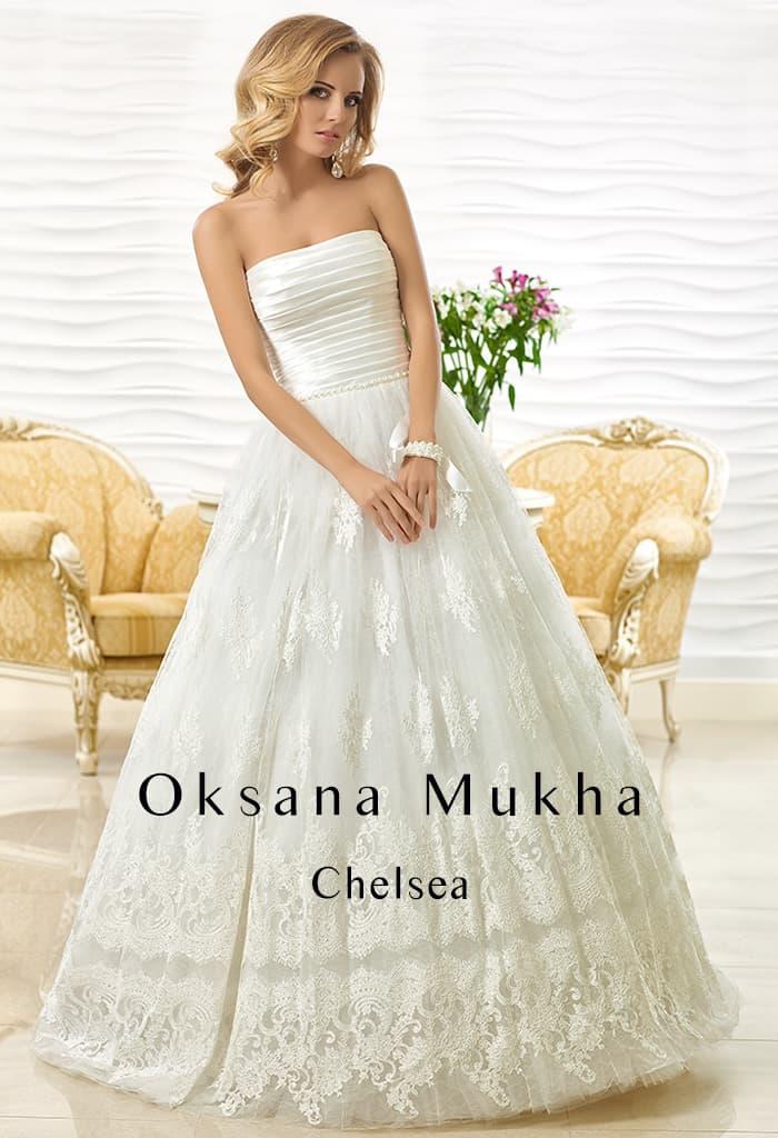 Пышное свадебное платье с оригинальным корсетом с горизонтальными складками.