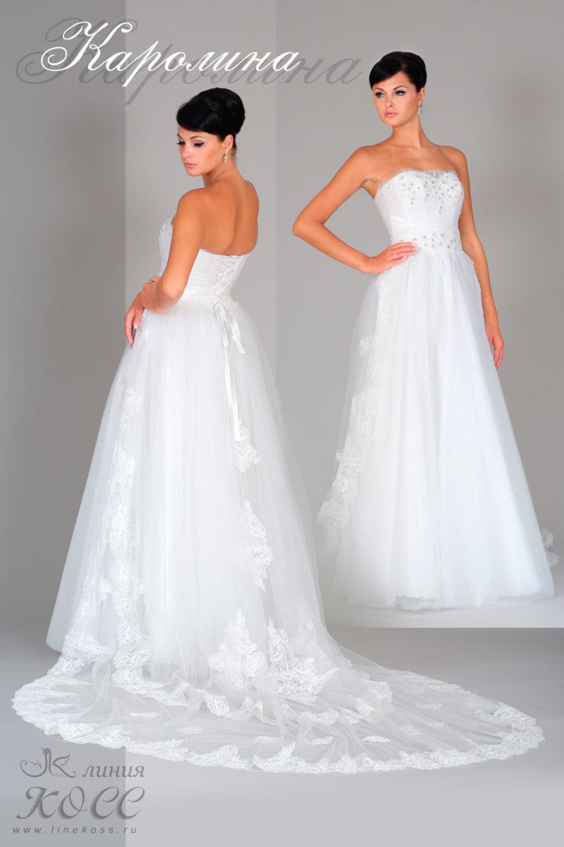 Открытое свадебное платье с лифом прямого кроя и юбкой «принцесса» со шлейфом.