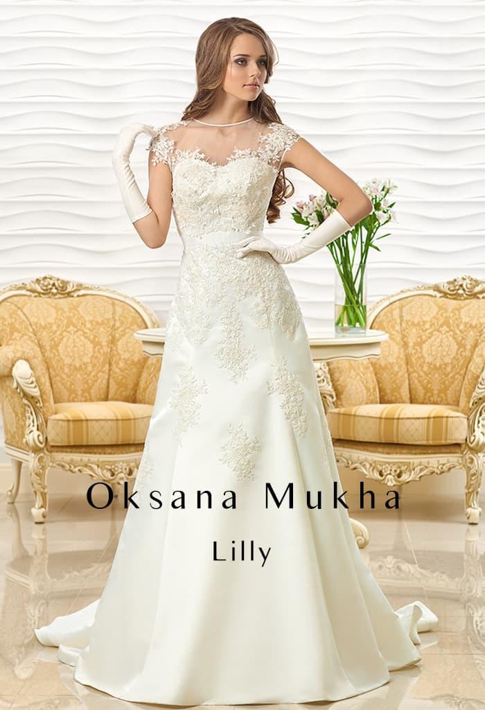 Элегантное свадебное платье «принцесса» с отделкой кружевом на тонкой ткани.