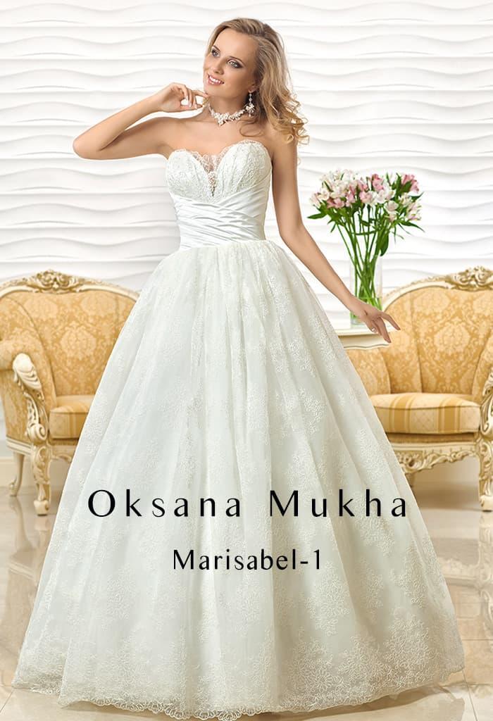 Торжественное свадебное платье с выразительным лифом и пышной фактурной юбкой.