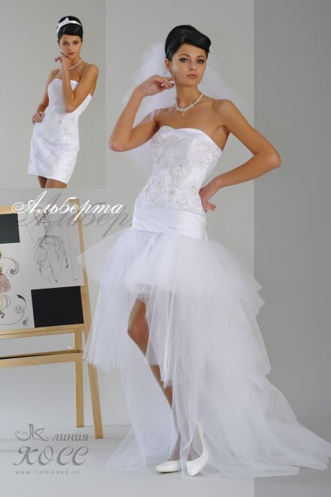 Эксцентричное свадебное платье с пышной полупрозрачной юбкой с оборками.