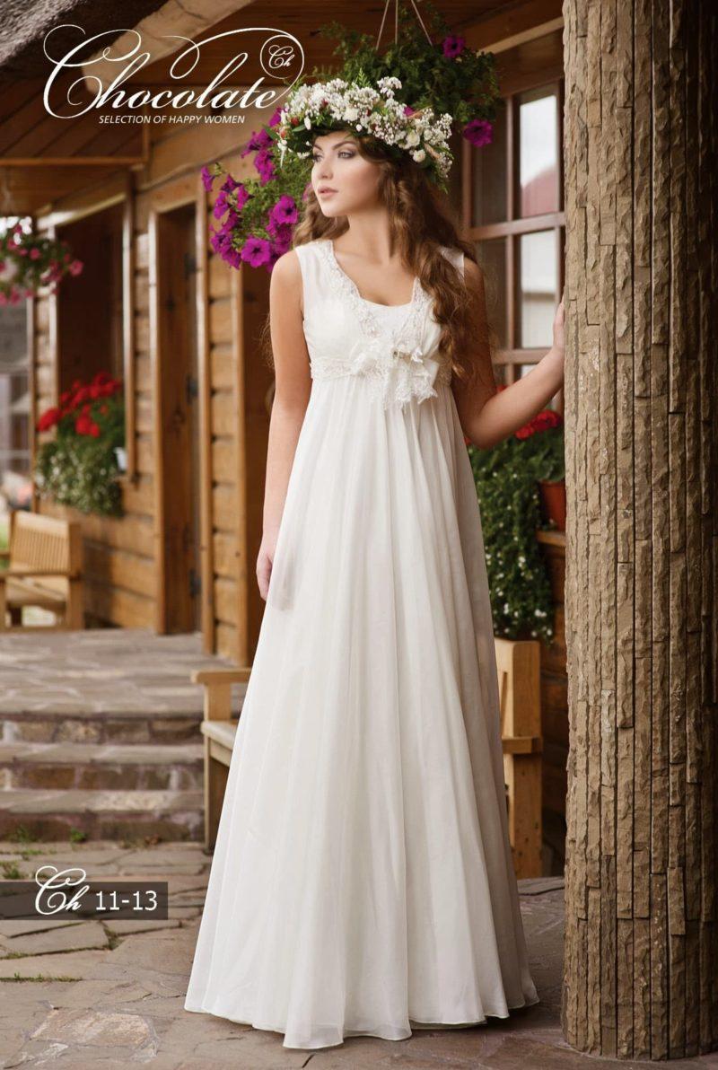 свадебное платье в греческом стиле с пышным бантом под лифом.