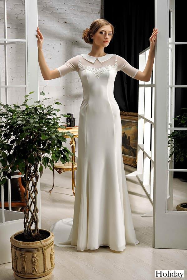 Закрытое свадебное платье облегающего кроя с изящным острым воротником.