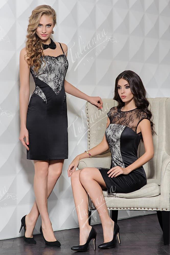 Черное вечернее платье-футляр с кружевной отделкой.