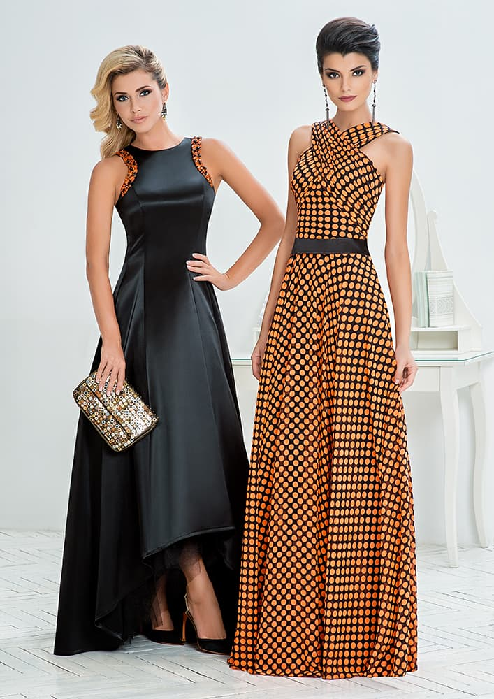 Вечернее платье из атласной ткани с изящным оформлением верха.