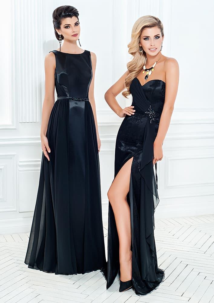 Черное вечернее платье с открытым лифом и драматичным разрезом на юбке.