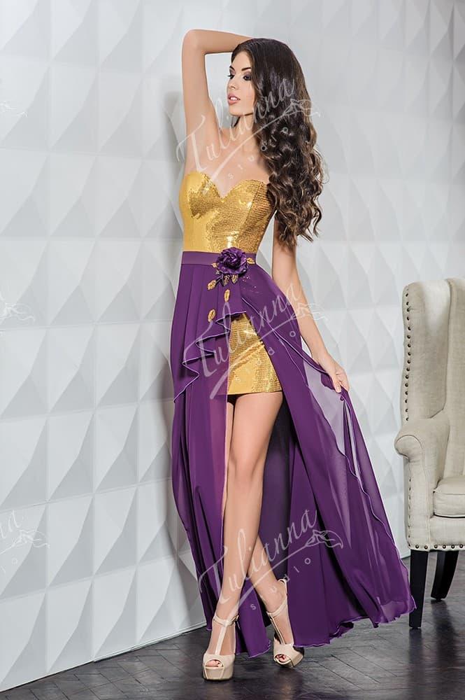 Роскошное вечернее платье с золотыми пайетками и верхней юбкой.