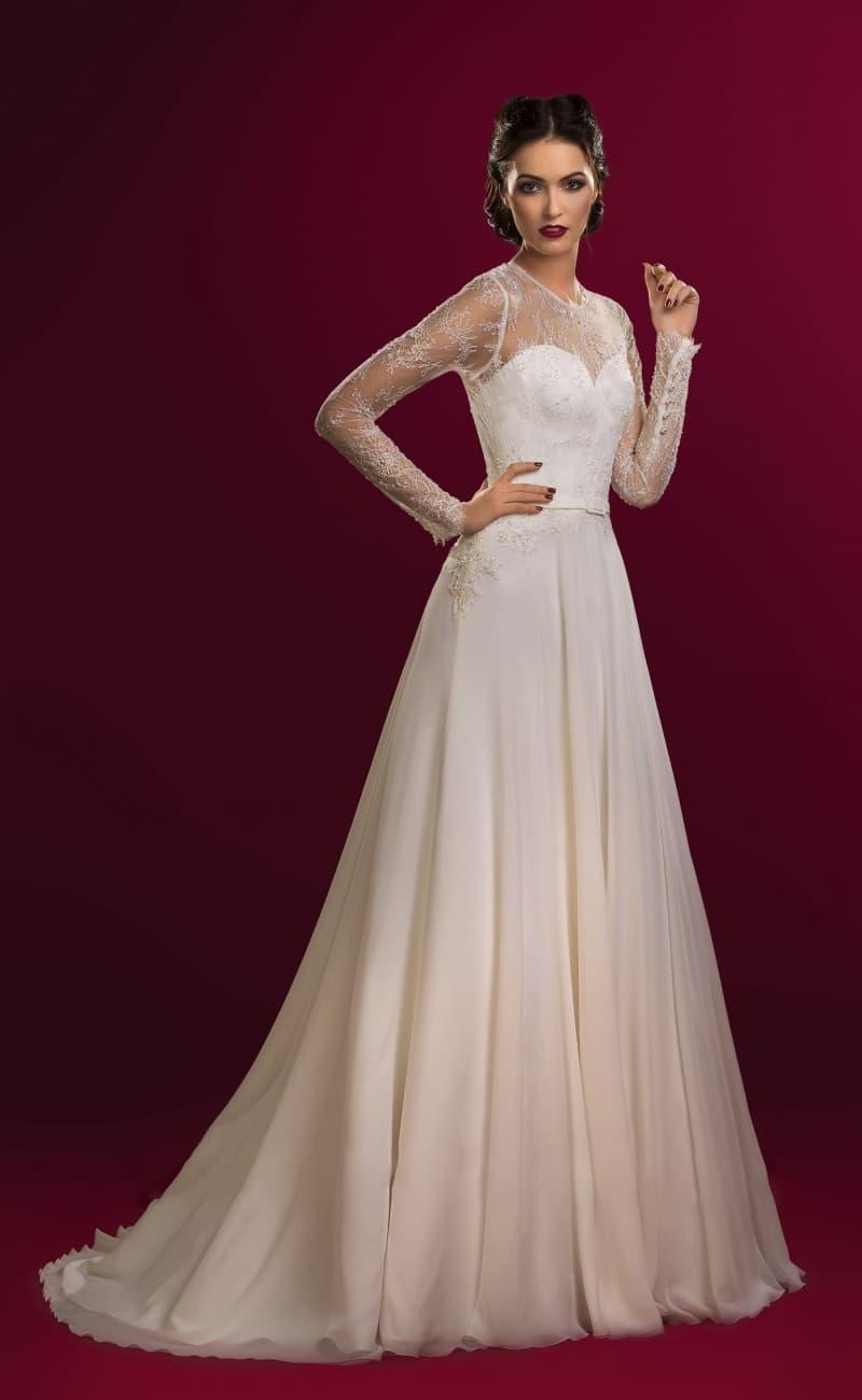 Деликатное свадебное платье с шифоновой юбкой и закрытым верхом с длинными рукавами.