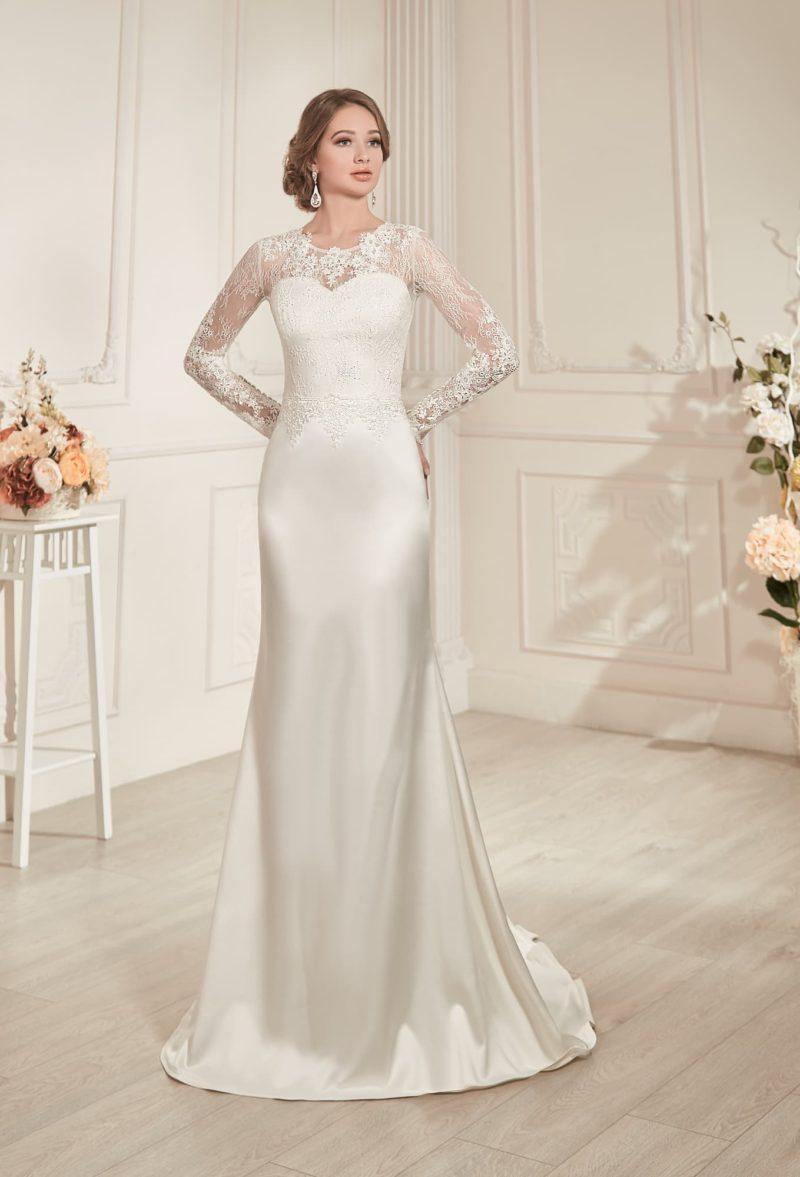 Прямое свадебное платье с закрытым верхом, вырезом на спинке и романтичным кружевным декором.