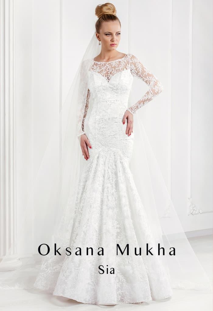 Кружевное свадебное платье «рыбка» с длинным рукавом и круглым вырезом.