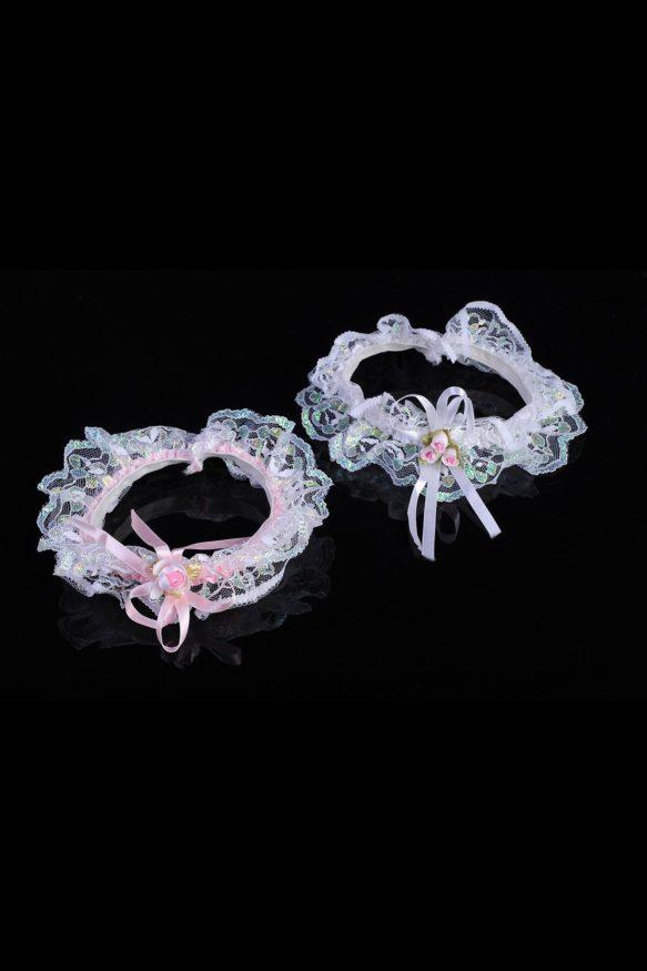 Комплект из двух бело-розовых кружевных подвязок.