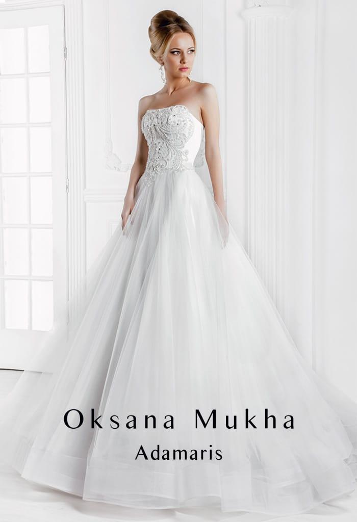 Стильное свадебное платье «принцесса» с многослойной юбкой и атласным корсетом с вышивкой.