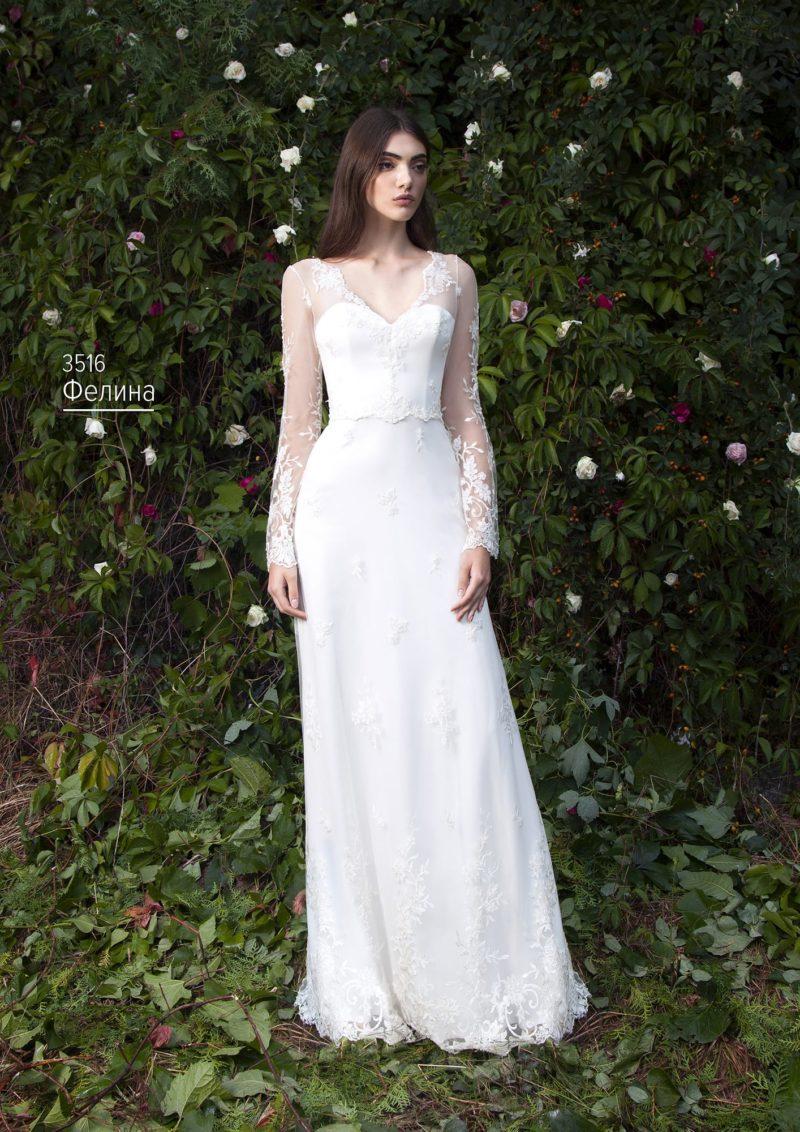Классическое свадебное платье с небольшим вырезом и прозрачным рукавом с аппликациями.