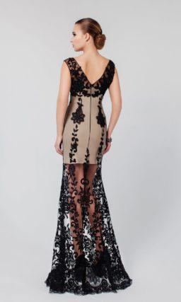 Оригинальное вечернее платье с бежевой подкладкой и черным кружевом, создающим длинную юбку.