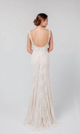 Кружевное вечернее платье с открытой спинкой, округлым декольте и завышенной талией.