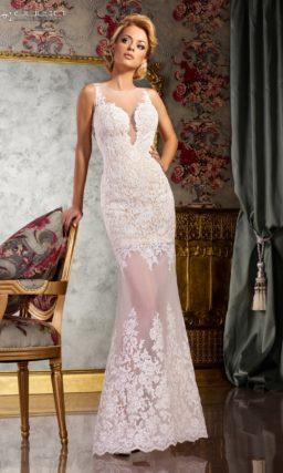 Кружевное свадебное платье с полупрозрачной юбкой и вырезом на спинке.