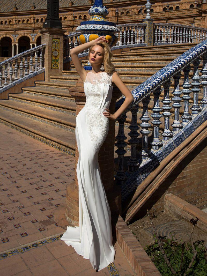 Свадебное платье с ажурной спинкой, идеально обрисовывающее каждый изгиб фигуры.