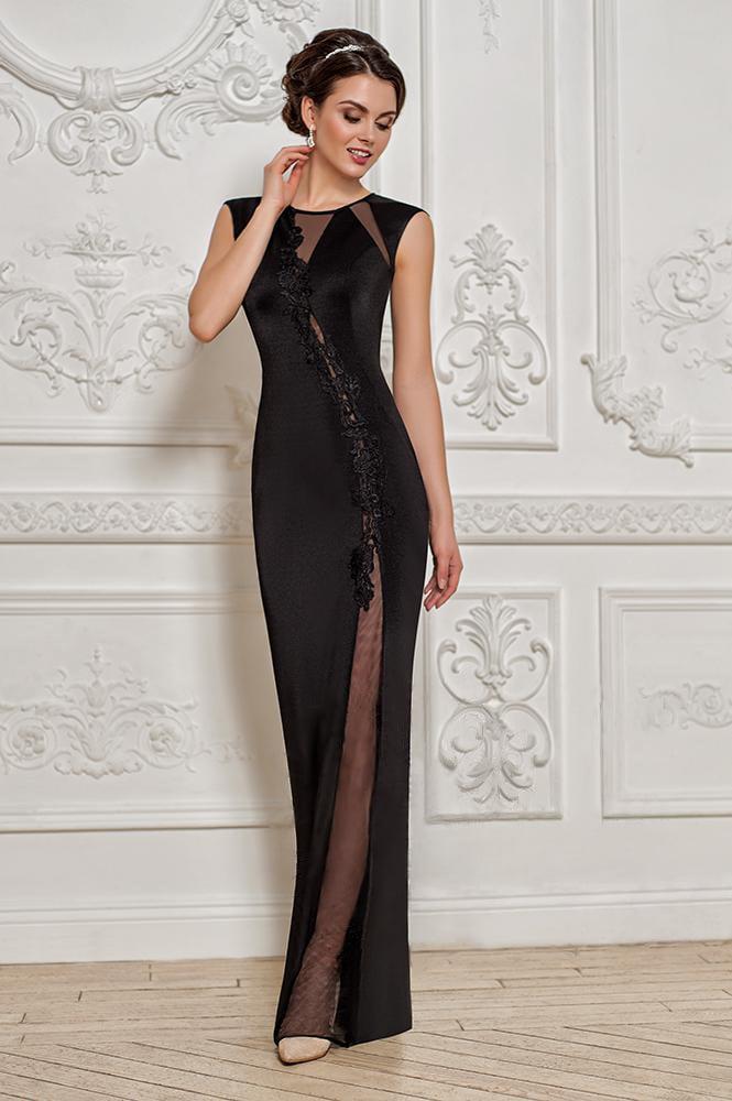 Потрясающее вечернее платье черного цвета с полупрозрачной вставкой по всей длине.