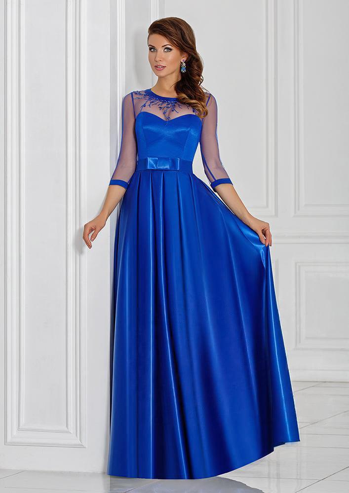 Стильное вечернее платье с длинным полупрозрачным рукавом и атласной юбкой.