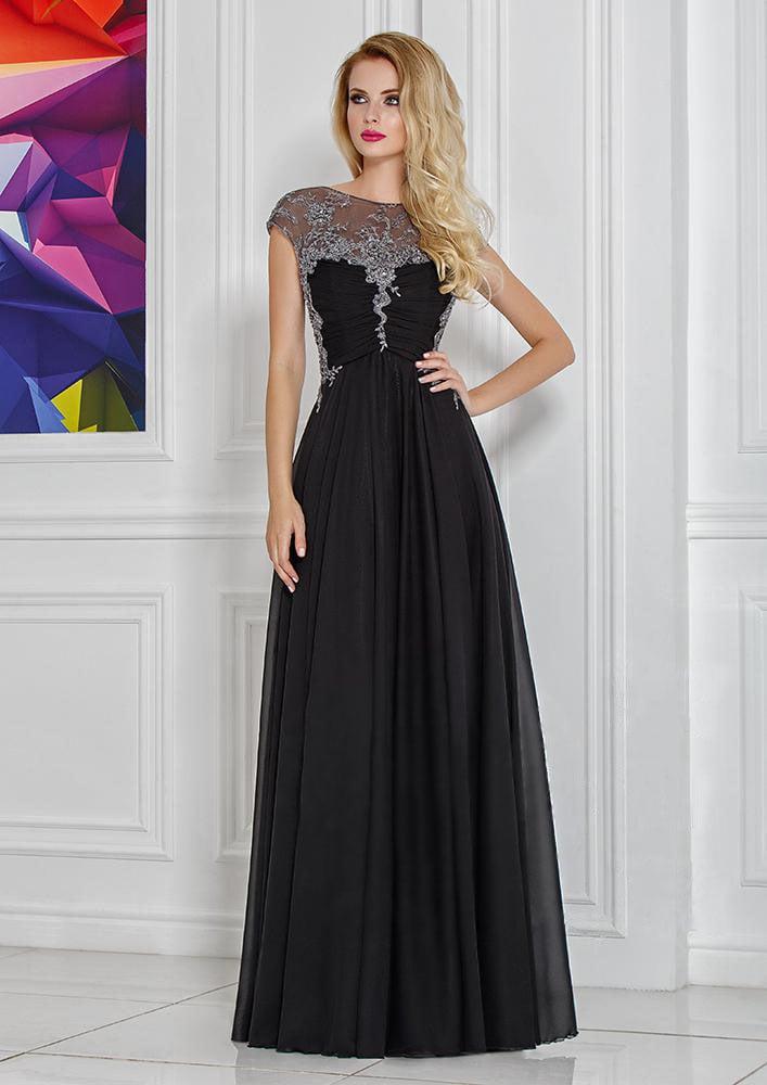 Черное вечернее платье с сияющей вставкой над лифом и отделкой драпировками.