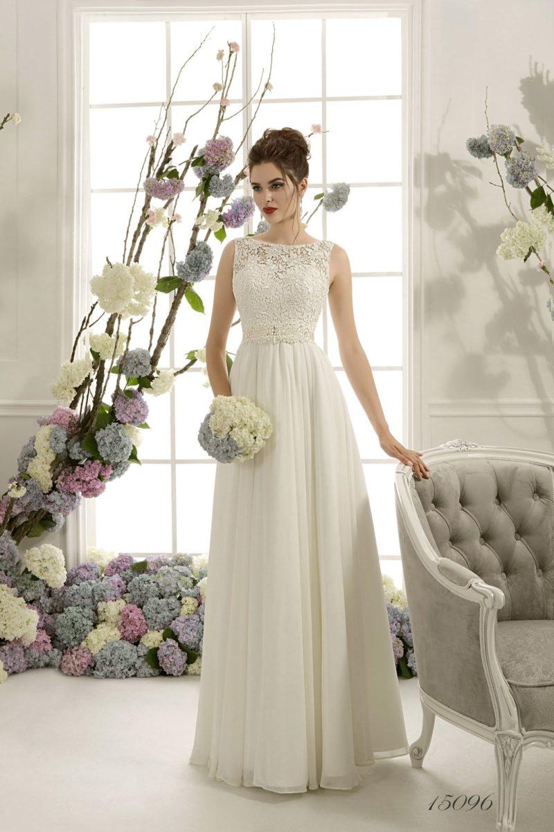 Изысканное свадебное платье с женственной юбкой прямого кроя и кружевным верхом.