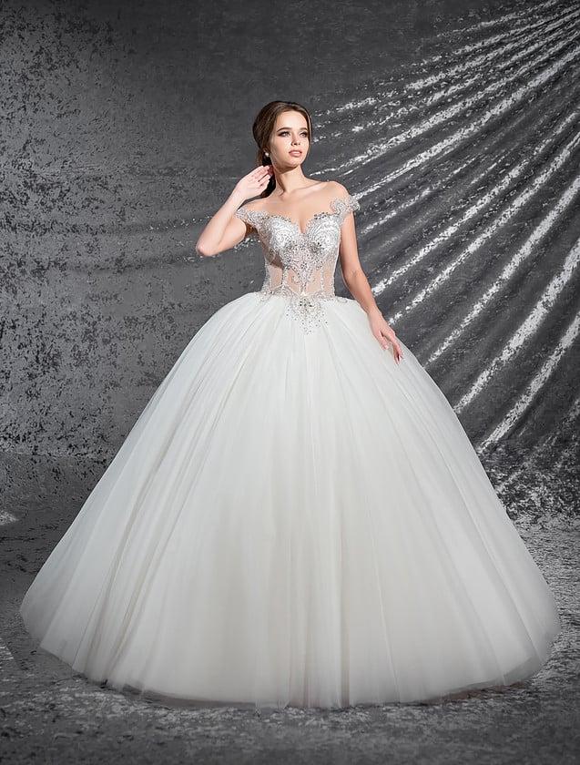 Шикарное свадебное платье с многослойным низом и пудрового цвета корсетом с кружевом.