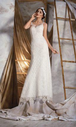 Прямое свадебное платье, покрытое необычным кружевом по всей длине, включая вырез сзади.