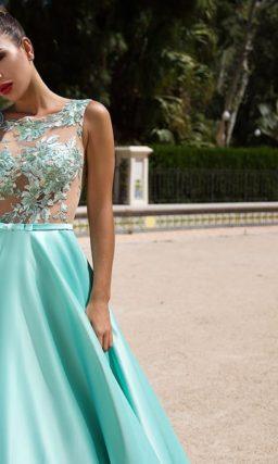 Эффектное вечернее платье с пышной юбкой цвета морской волны.