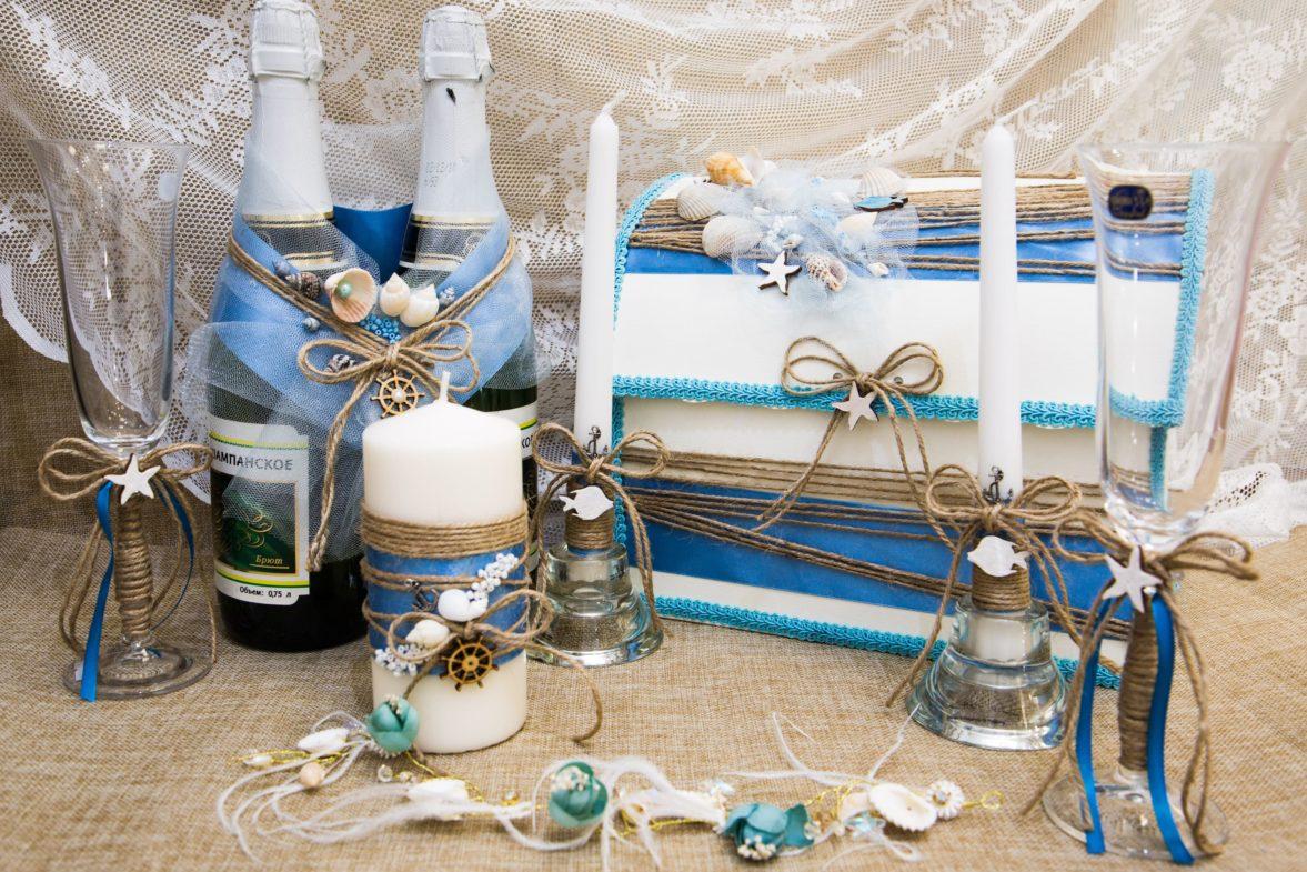Оригинальный свадебный набор в синих тонах, оформленный в морском стиле.