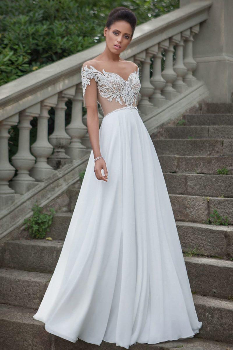 Свадебное платье с полупрозрачным верхом и притягательным вырезом на спинке.