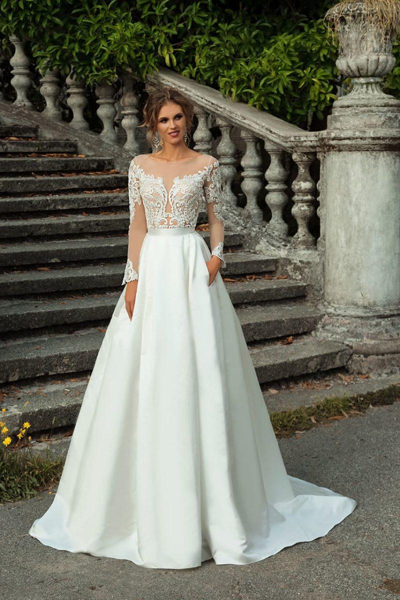 Свадебное платье с иллюзией полупрозрачности и скрытыми карманами на юбке.