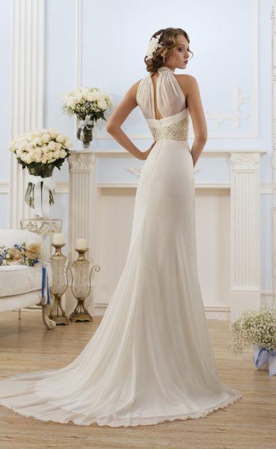 Стильное свадебное платье с оригинальной полупрозрачной спинкой с вырезом и юбкой со шлейфом.