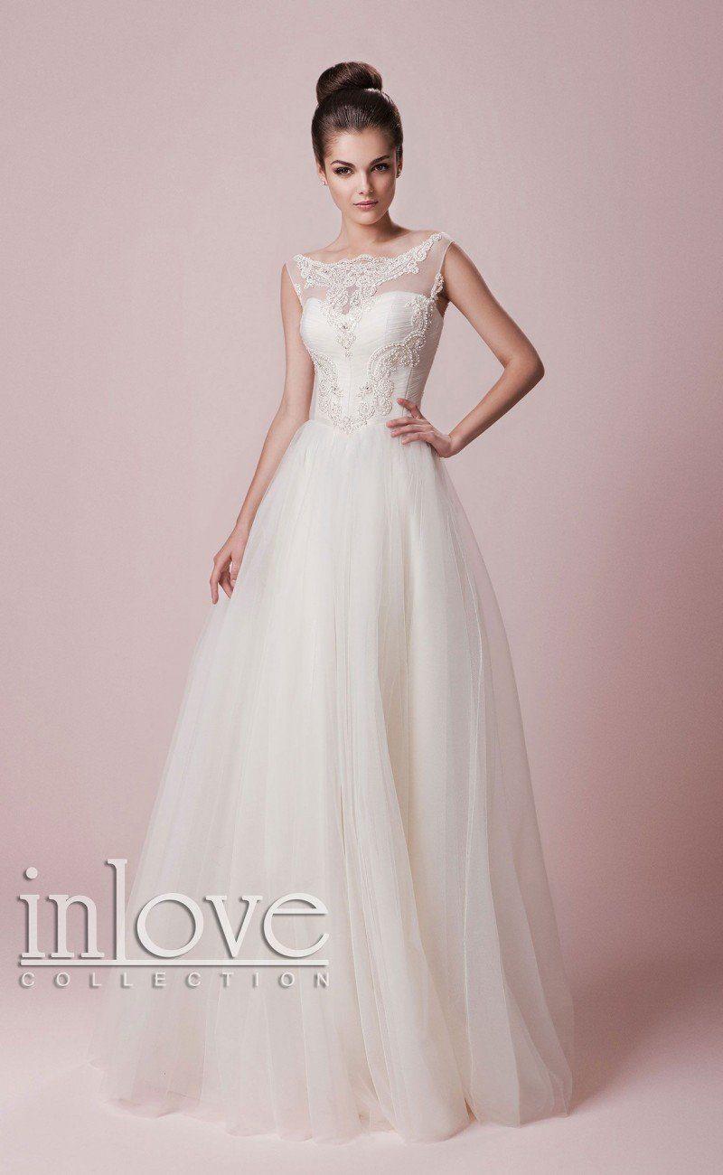 Свадебное платье классического кроя «принцесса» с романтичным кружевным декором верха.