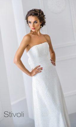 Фактурное свадебное платье элегантного кроя с широким поясом.