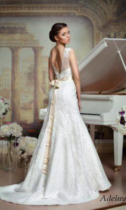 Великолепное свадебное платье «рыбка» с длинным шлейфом и полупрозрачной вставкой над лифом.