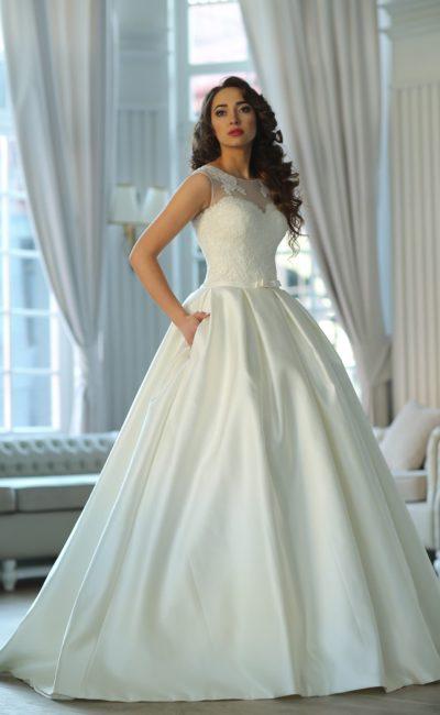 Роскошное свадебное платье с пышной атласной юбкой с карманами и кружевным верхом.