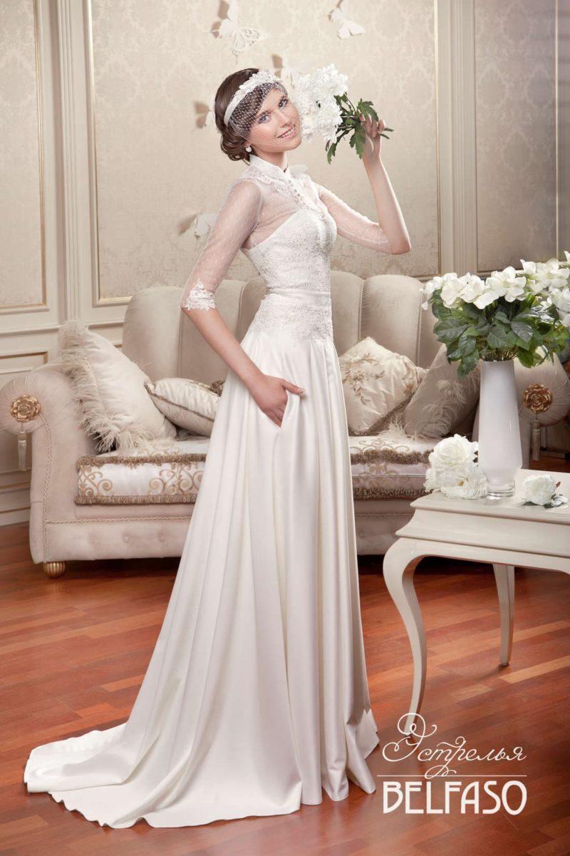 Свадебное платье-трансформер со съемной юбкой и полупрозрачными рукавами длиной до локтя.