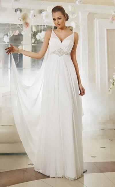 Изящное свадебное платье с полупрозрачными бретелями и оригинальным шлейфом сзади.