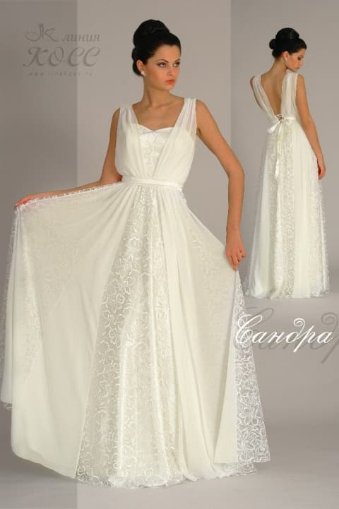 Прямое свадебное платье из ажурной ткани с женственным лифом с тонкими бретелями.