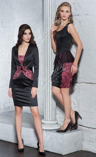 Черное вечернее платье облегающего кроя с длинным рукавом.