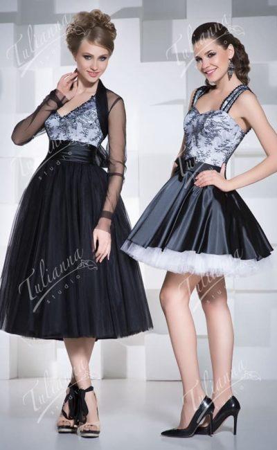 Черное вечернее платье с пышной юбкой и широким поясом.