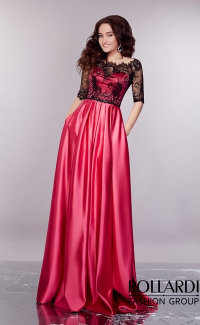 Малиновое вечернее платье с роскошной юбкой со скрытыми карманами и кружевным верхом.