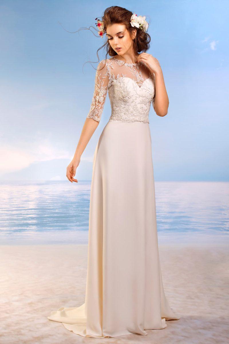 Стильное свадебное платье прямого кроя с длинным рукавом, покрытое кружевной тканью.