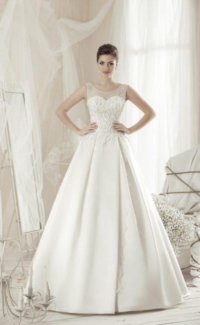 Свадебное платье с бисерной вышивкой по тонкой ткани верха и роскошной атласной юбкой.