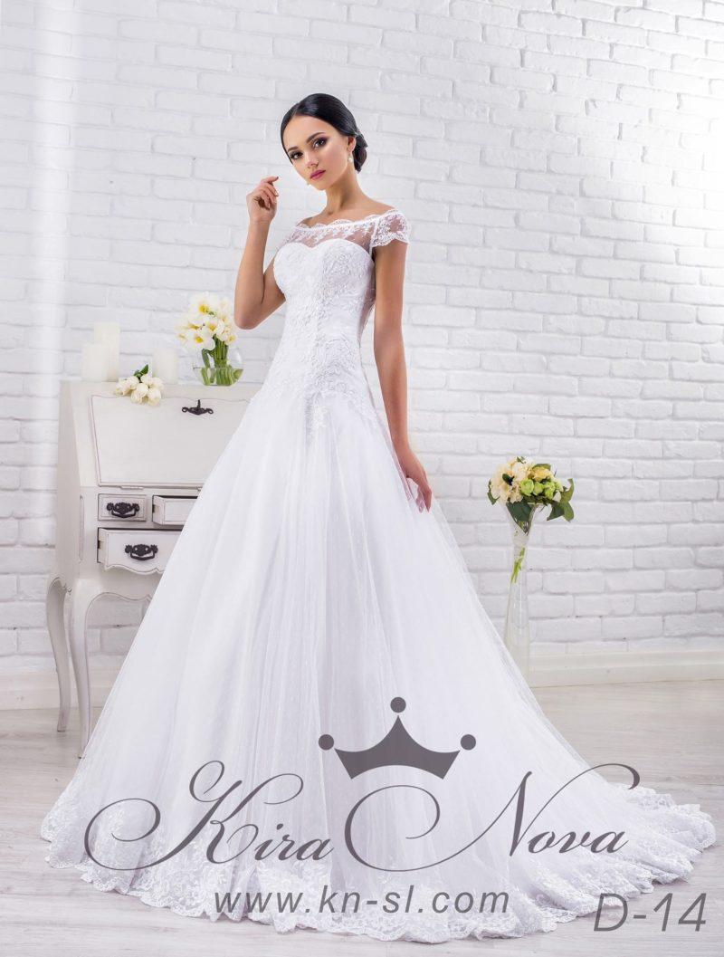 Пышное свадебное платье с фигурным портретным декольте и небольшим вырезом на спине.