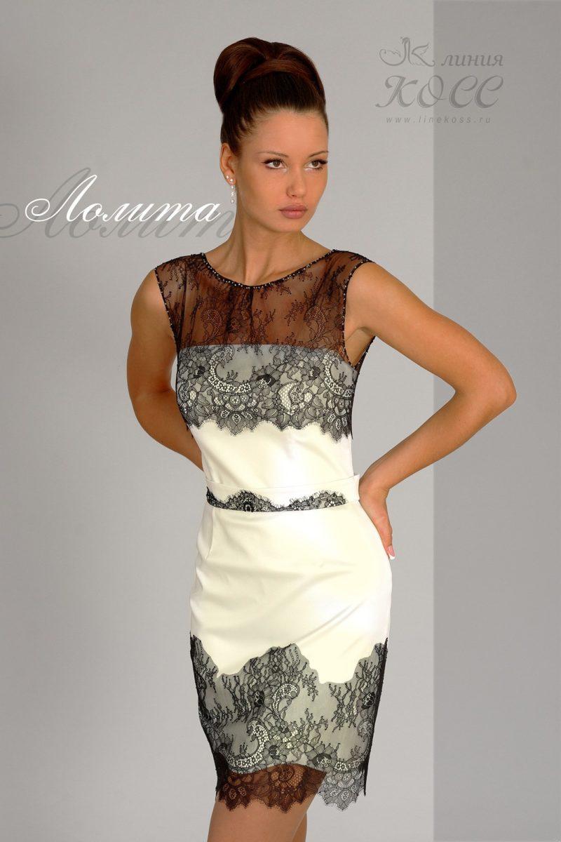 Элегантное вечернее платье-футляр с тонкой кружевной отделкой.