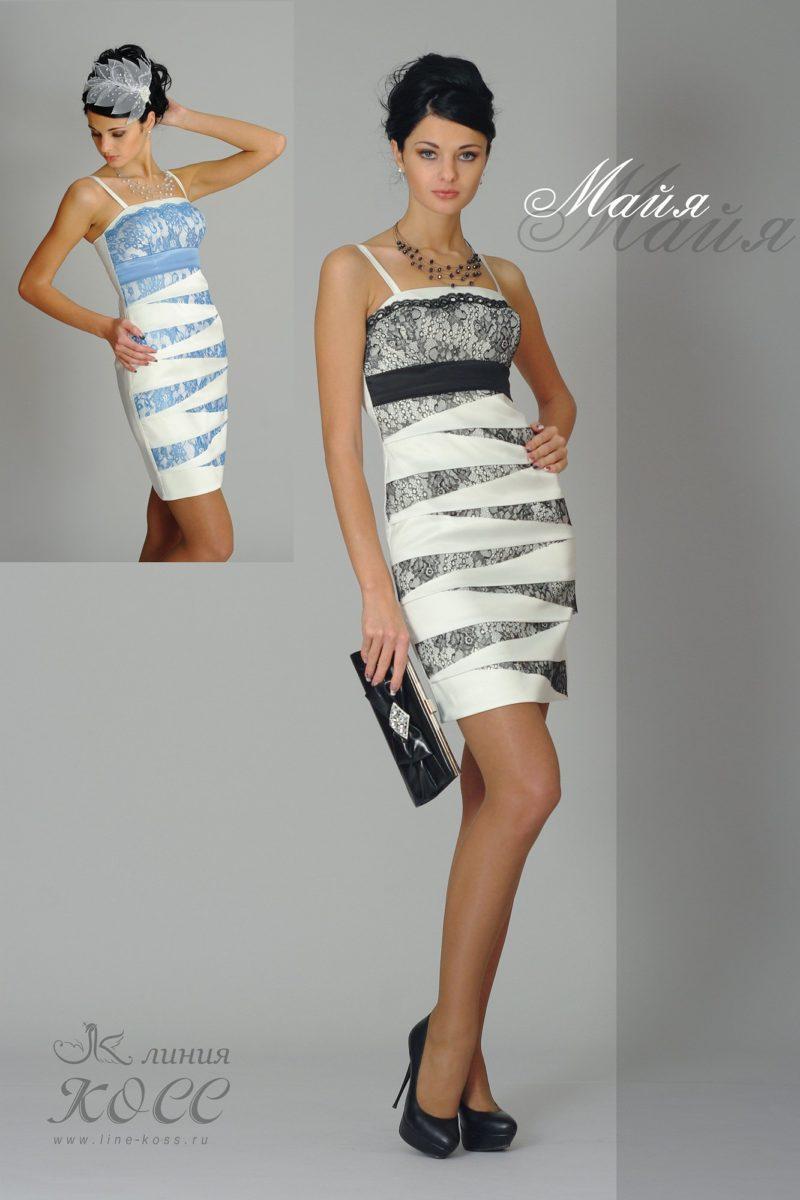 Оригинальное вечернее платье-футляр с диагональными полосами отделки.
