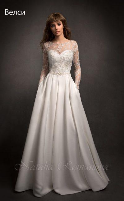 Свадебное платье «принцесса» со скрытыми карманами и закрытым кружевным верхом с рукавами.