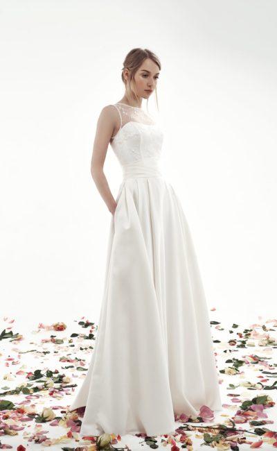 Свадебное платье со скрытыми карманами в юбке «принцесса» и закрытым лифом.